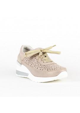 Sneaker de Descanflex de piel en color beig y con dibujo troquelado y cuña